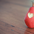 Red Pear With Heart Shape Bit Poster by Danielle Donders - Mothership Photography