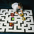 Researcher Testing Lego Robots Playing Pacman Poster by Volker Steger