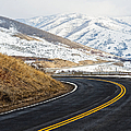 Road Through a Snowy Mountain Landscape Print by Thom Gourley/Flatbread Images, LLC