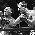 Rocky Marciano Landing A Punch by Everett