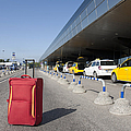 Rolling Luggage Outside an Airport Terminal Print by Jaak Nilson