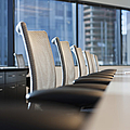 Row of Chairs and a Table in a Conference Room Print by Jetta Productions, Inc