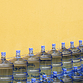 Rows of Water Jugs Print by Jeremy Woodhouse