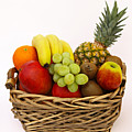 Selection Of Tempting Fresh Fruits In A Basket Poster by Rosemary Calvert