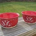 set of small red bowls Poster by Monika Hood