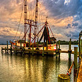 Shrimp Boat at Sunset Print by Debra and Dave Vanderlaan