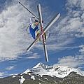 Skiing Aerial Maneuvers Off A Jump Poster by Gordon Wiltsie