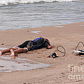 Small surfer lying on beach Print by Christopher Purcell