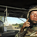 Soldier Monitors The Progress Of A 67 Print by Stocktrek Images