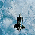 Space Shuttle Orbiting Above Earth Print by Stockbyte