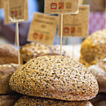 Stacks Of Fresh Bread For Sale Print by Hybrid Images