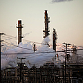 Steam Plumes At Oil Refinery Poster by Hal Bergman
