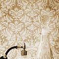 Still life of perfume decanters Print by Marlene Ford