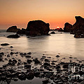 Sunset on a rock Print by Keith Kapple