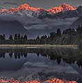 Sunset Reflection Of Lake Matheson Poster by Colin Monteath