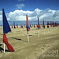 Sunshade on the beach. Deauville. Normandy Print by Bernard Jaubert