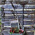 Tall Log Cabin and Garden Tools Print by Linda Phelps