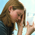 Teenager With Headache Holds Dissolving Painkiller Poster by Damien Lovegrove