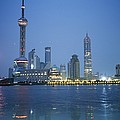 The Shanghai Skyline And Riverfront Print by Raul Touzon