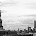 Tourists visiting the Statue of Liberty Print by Sami Sarkis