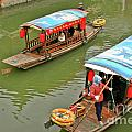 Traffic in Qibao - Shanghai's local ancient water town Print by Christine Till