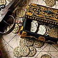 Treasure box with old pistol Print by Garry Gay