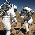 Two Astronauts Collect Soil Samples Poster by Stocktrek Images