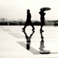 Two Men In Rain With Their Reflections Poster by Nadia Draoui