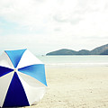 Umbrella On Sand Print by Grace Oda