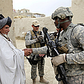 U.s. Army Soldier Shakes Hands With An Poster by Stocktrek Images