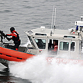 U.s. Coast Guardsmen Aboard A Security Poster by Stocktrek Images