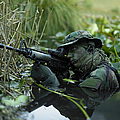 U.s. Navy Seal Crosses Through A Stream Poster by Tom Weber