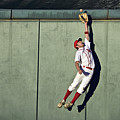 Usa, California, San Bernardino, Baseball Player Making Leaping Catch At Wall Print by Donald Miralle