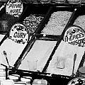 various spices including curry black pepper couscous and papricka on stall at the market in nabeul Print by Joe Fox