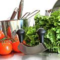 Vegetables with kitchen pots and utensils on white  Print by Sandra Cunningham