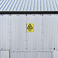 Warning Sign on an Industrial Building Poster by Iain Sarjeant