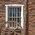 Window in Stone Building With Wagon Wheel Print by Thom Gourley/Flatbread Images, LLC