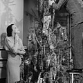 Woman Assisting Man Placing Star On Top Of Christmas Tree, (b&w) Print by George Marks
