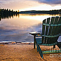 Wooden chair at sunset on beach Print by Elena Elisseeva