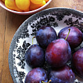 Yellow Cherry Tomatoes And Plums Print by Laura Johansen