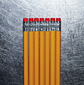 Yellow Pencils With Erasers On Stainless Steel. Print by ballyscanlon