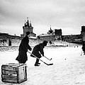 Young Russians Playing Hockey Print by Everett