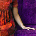 Young Woman in Red on Purple Couch Poster by Jill Battaglia
