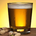 Beer in glass Poster by Blink Images