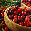 Cranberries in bowls Poster by Elena Elisseeva