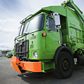 Garbage Truck Parked In A Parking Lot Print by Don Mason