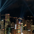 Laser show over city at night Poster by Sami Sarkis