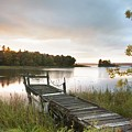 A Dock On A Lake At Sunrise Near Wawa Print by Susan Dykstra