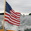 A Flag Waves On The Stern Of A Maine Poster by Heather Perry