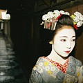 A Geisha In Traditional Costume Walks Print by Paul Chesley